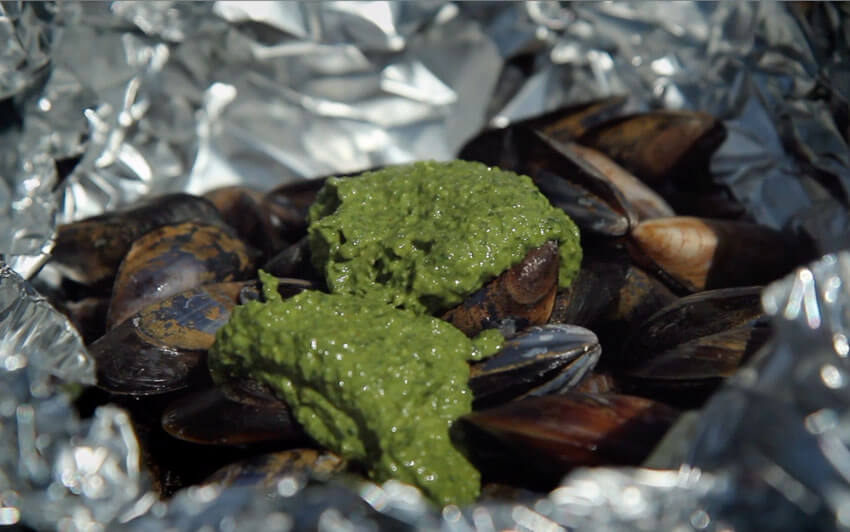 Sauce the mussels and then seal them tightly in foil - Gen Taylor Video Recipe