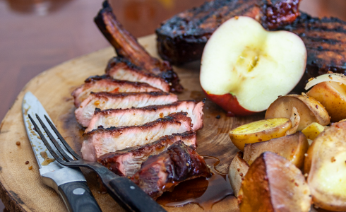 Apple Smoked Pork Chops on a Charcoal Grill